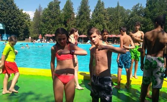 enjoying mineral pool during children's camp