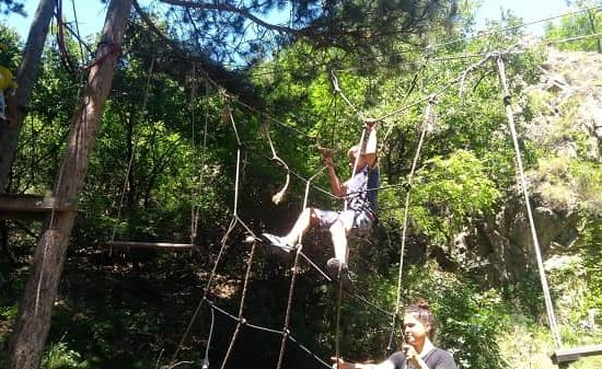 kid going through rope elements