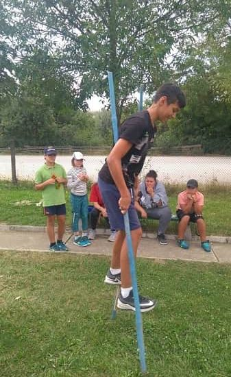 walking with stilts during children's camp