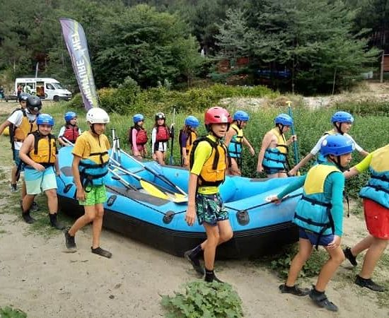 wearing rafting boat during children's camp