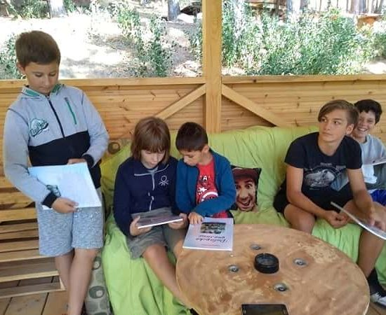 gathering for eco discussion during children's camp
