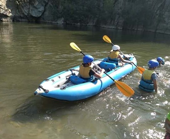 Kayak competition during children's camp