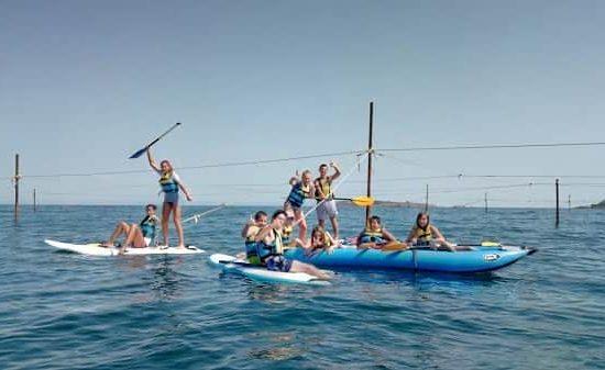 summer camp with sea kayaks